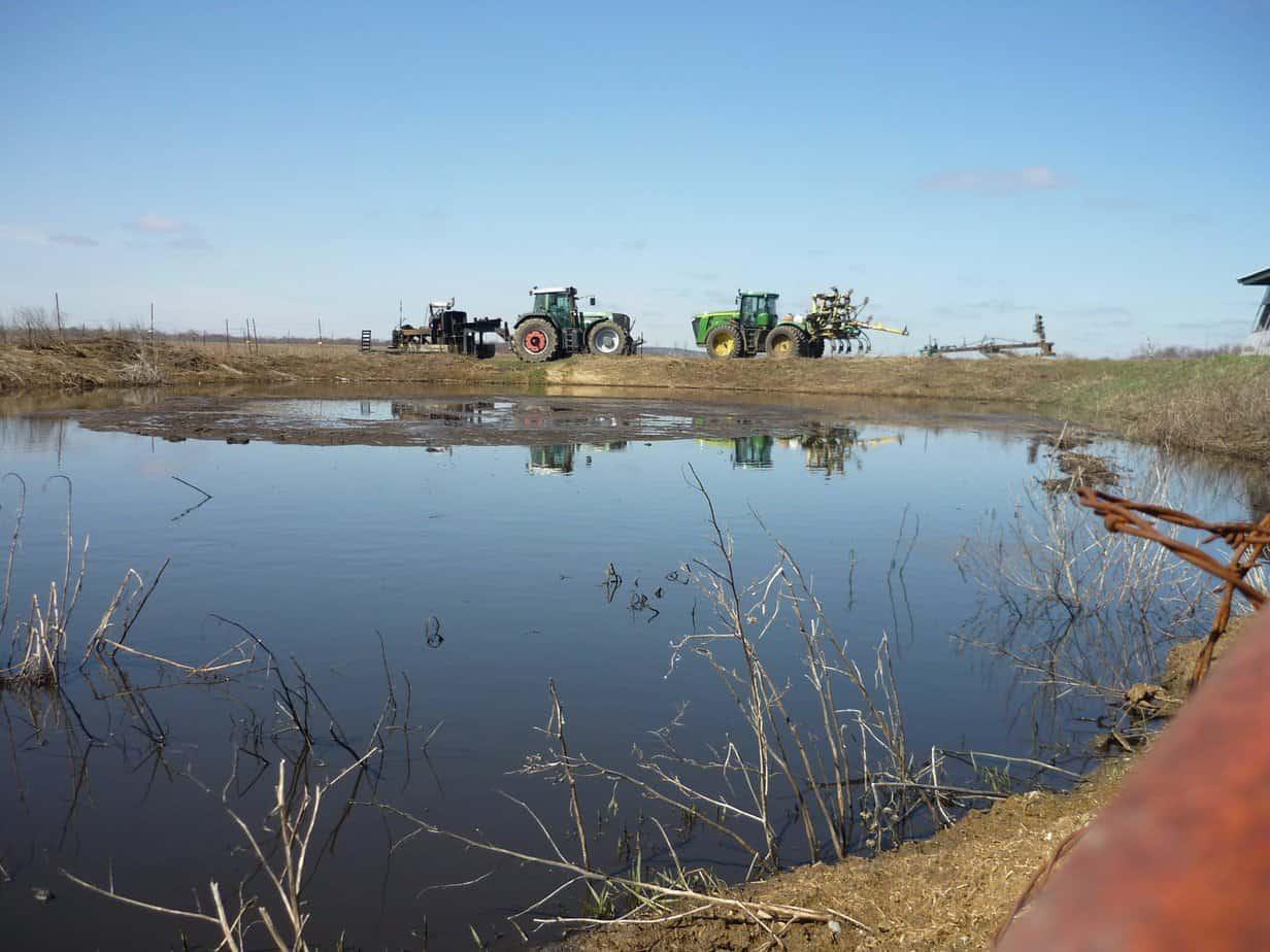 Tractors agitating the manure pit.