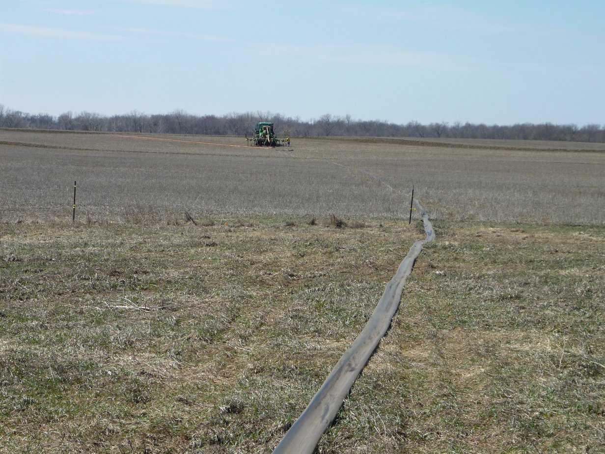 Manure hose in field.