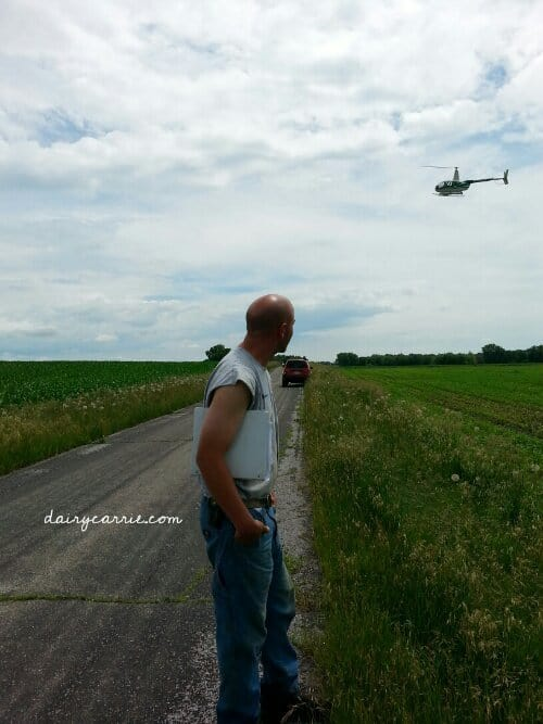 Helicopter spraying fields