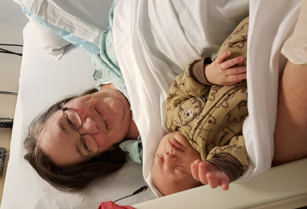 Grandma getting to hold her grandson for the first time.