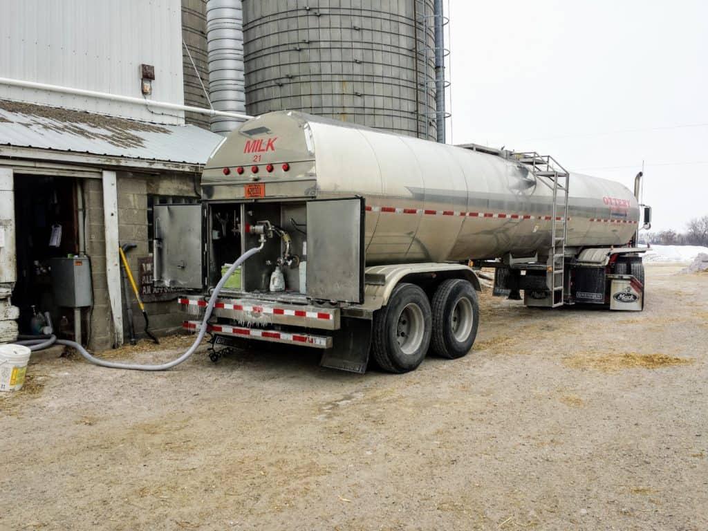 Milk truck picking up milk