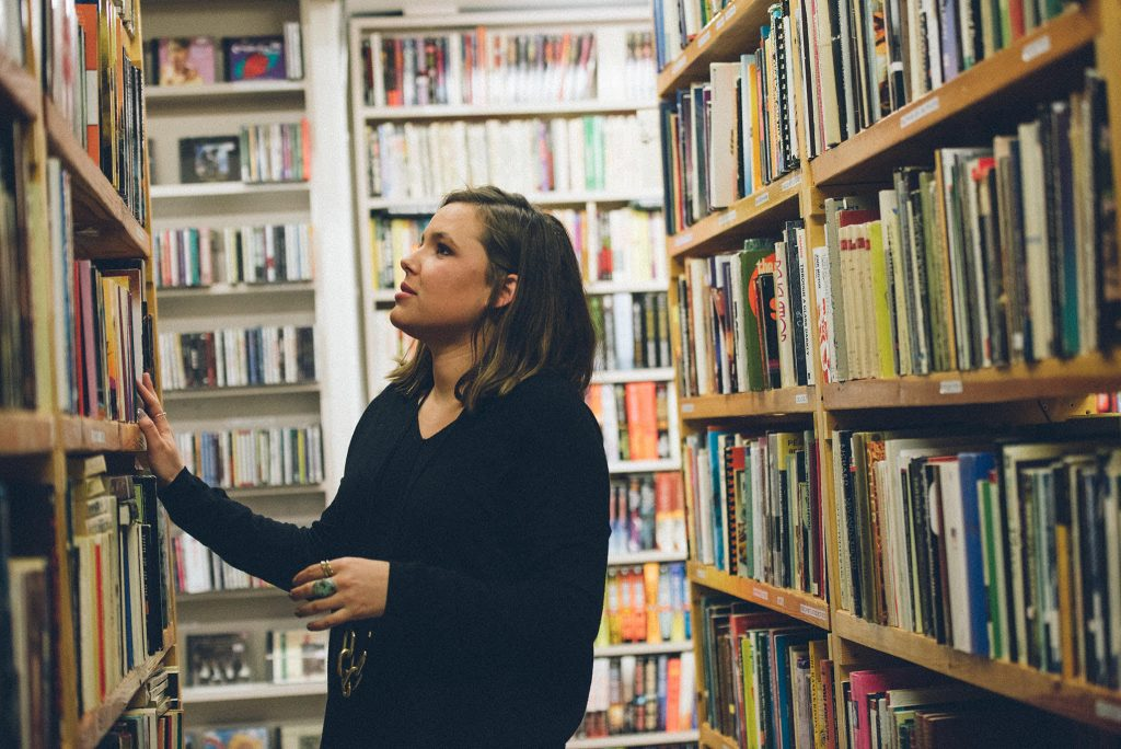 Young woman browsing books at a library
